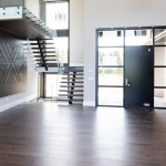 dark coloured engineered hardwood flooring in a front entrance of a modern home