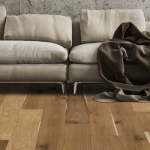 Beige couch on multi-tone plank flooring